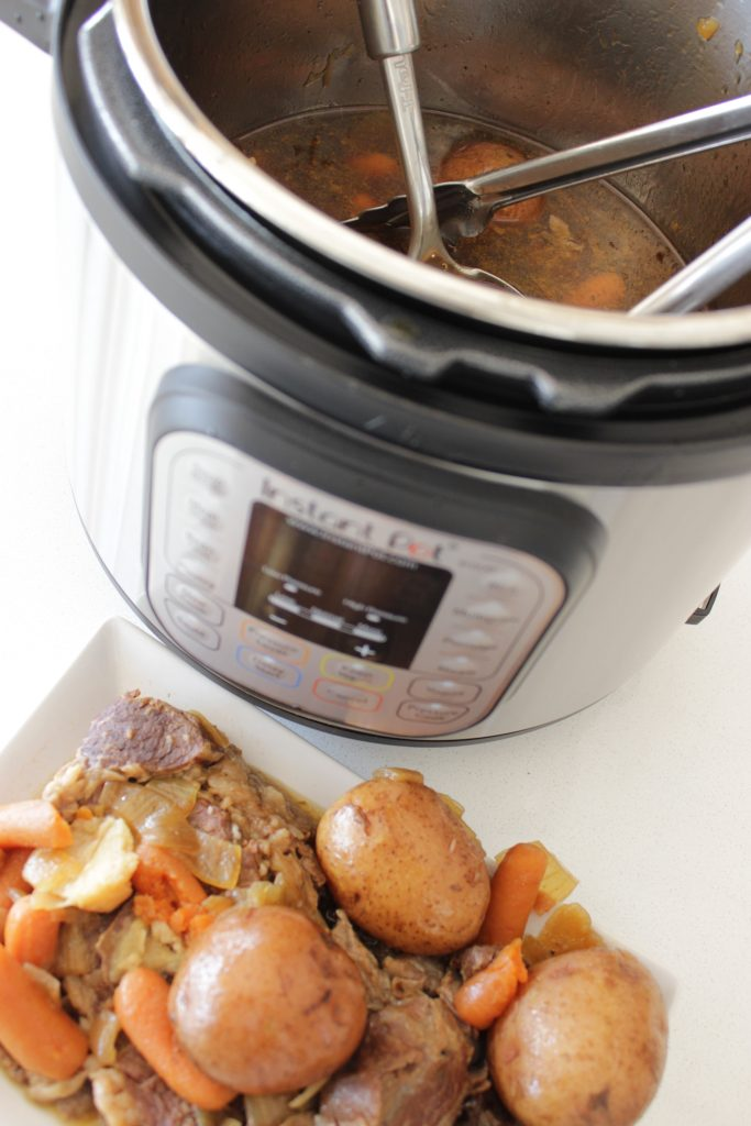 Instant Pot pot roast recipe on the plate and in the Instant Pot