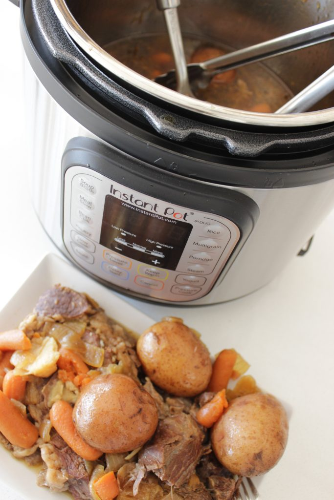 Instant Pot pot roast and potatoes on a plate - So good!