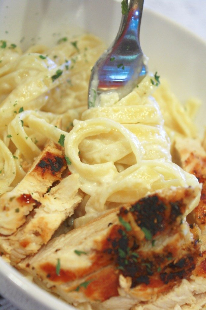 pasta with homemade alfredo sauce in a bowl