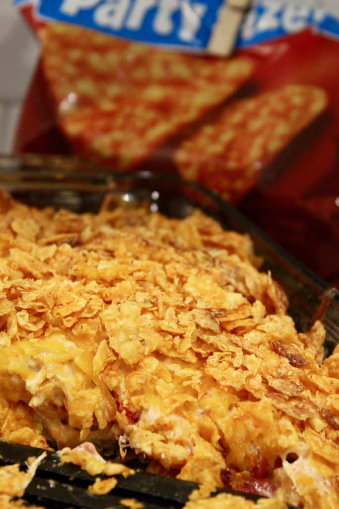 Dorito casserole in a dish with pieces missing