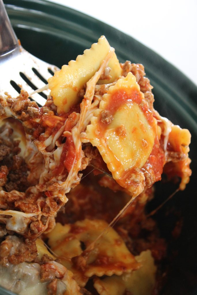 Ravioli coming out of the crock pot in my crockpot lasagna with ravioli