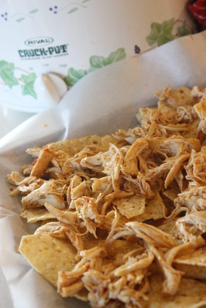 chicken nachos on a baking sheet