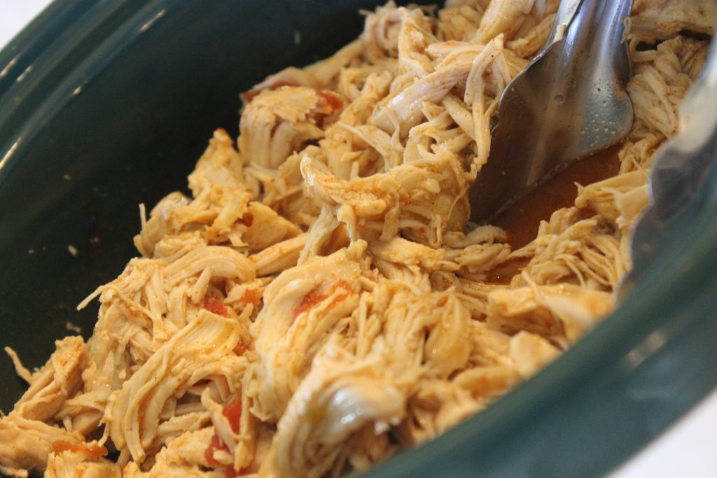Chicken for nachos that is waiting in the Crock Pot