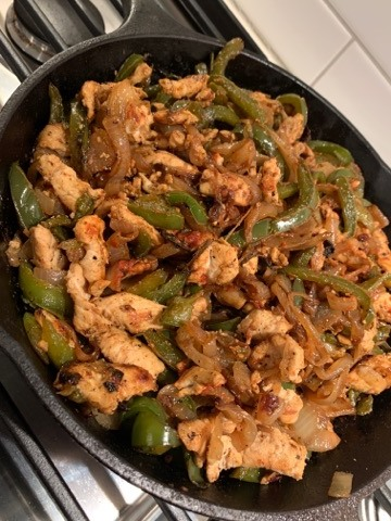 fajitas in a cast iron pan made at home