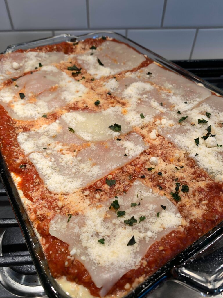 lasagna without ricotta cheese ready to go in the oven