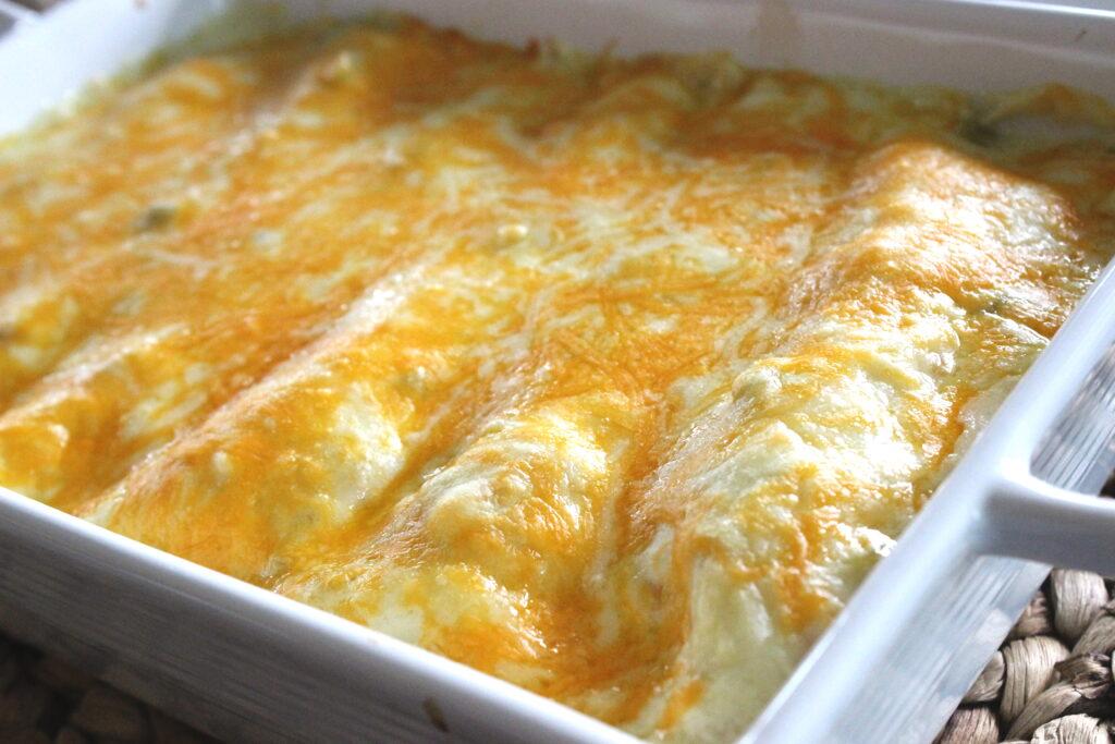 white chicken enchiladas in a white dish