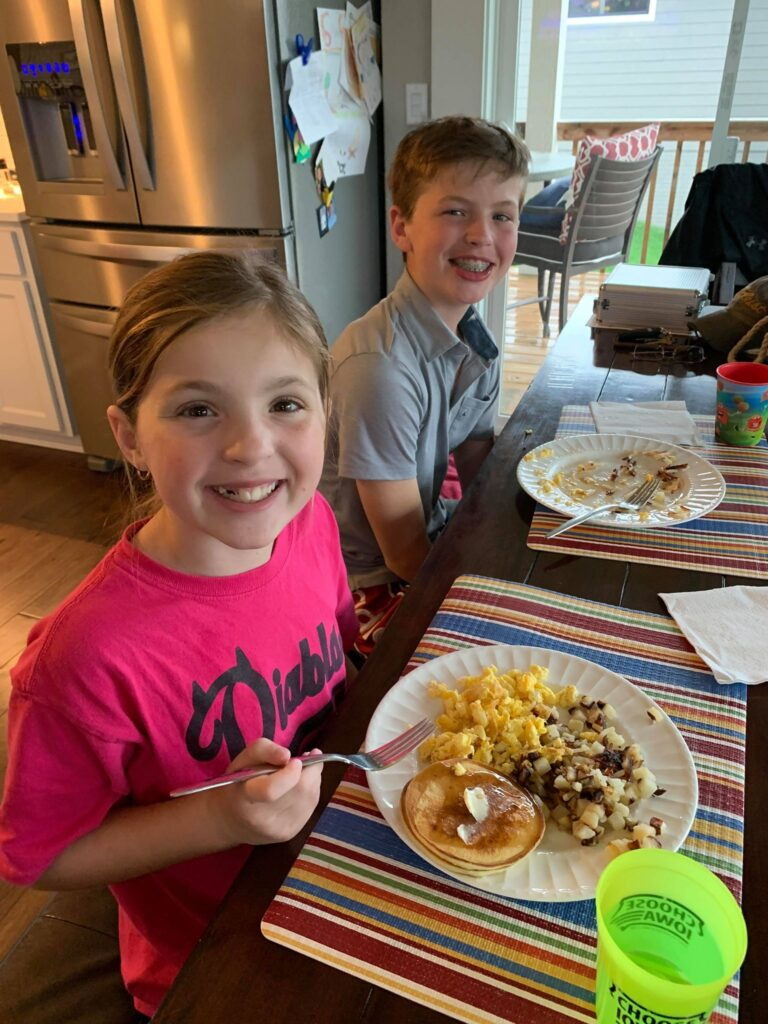 kids eating homemade pancakes that our daughter made