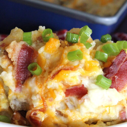 potatoes with cheese, green onions and bacon in a dsih