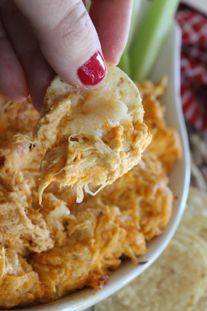 bite of buffalo chicken dip on a chip